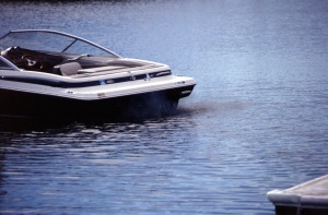 A powerboat emitting carbon monoxide while docked. Photo Courtesy of The U.S. Coast Guard